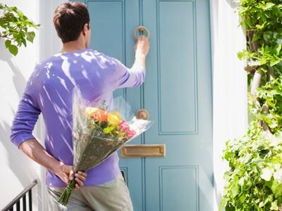 man-holding-flowers